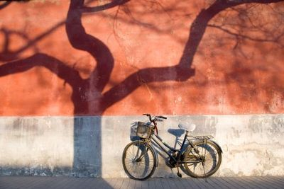 Bike parked against a wall in Beijing