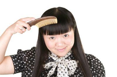 Girl.combing.hair