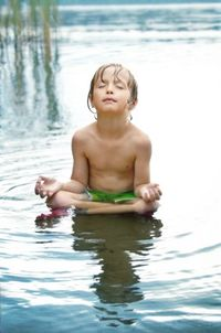 Boy meditating in water