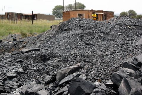A pile of coal on the side of the road