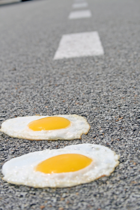 Eggs cooking on hot pavement