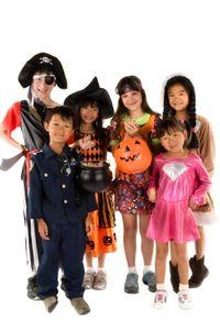 Kids trade halloween costumes