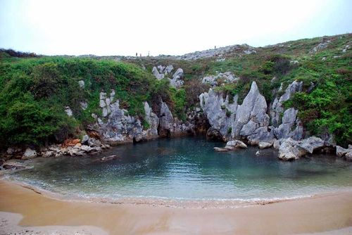 Playa de Gulpiyuri Llanes Spain weird beaches