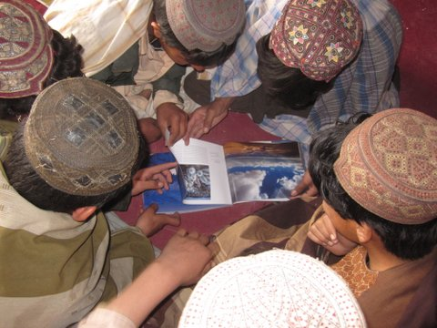 Shin Kalay students turning pages