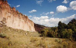 cliff face and valley at Bandelier National Monument
