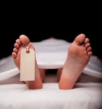 Dead body in morgue with toe tag