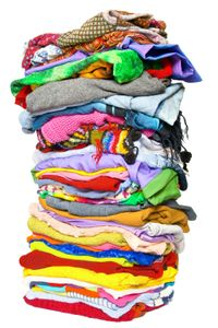 Tall Stack of Colorful, Folded Clothing