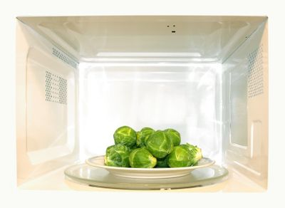 Plate of vegetables in microwave