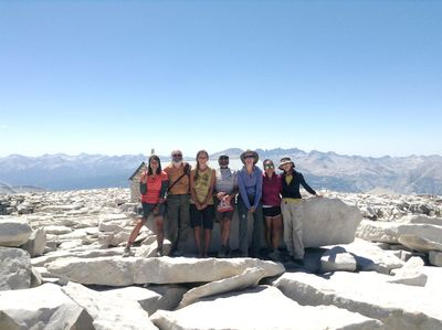The John Muir Trail hiking group on the Mt. Whitney Summit. L-R- Alyssa Solis '13, Prof. Brian Keeley, Sasha Heinen '15, Eric Radack P'14, President Laura Skandera Trombley, Lisa Hirata '16 and Lisa Geller '76
