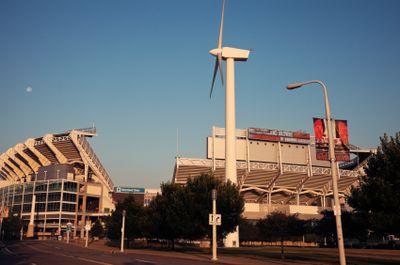 Football stadium with wind turbine