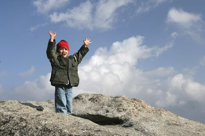 Kid celebrates a summit