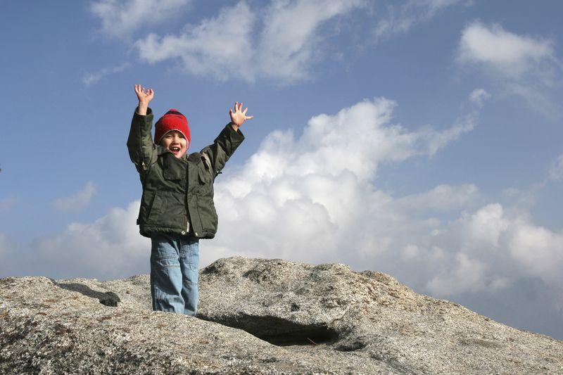 Kid celebrates a summit