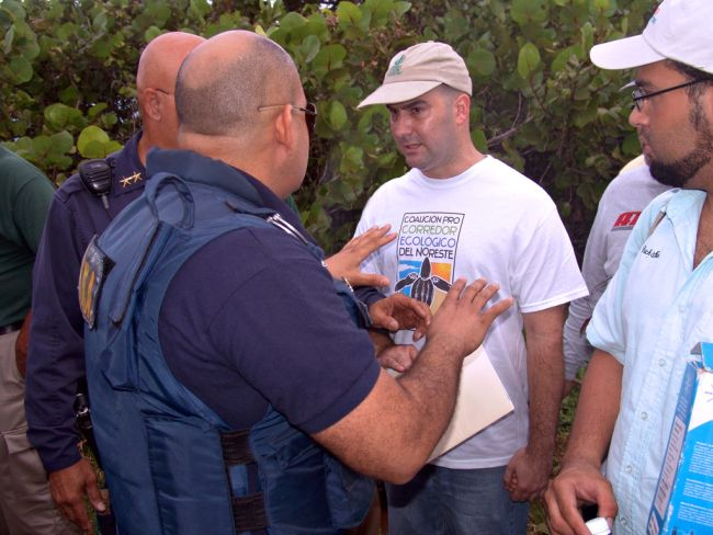 Luis Jorge Rivera Herrera engaging police officers at protest for the protection of the NEC