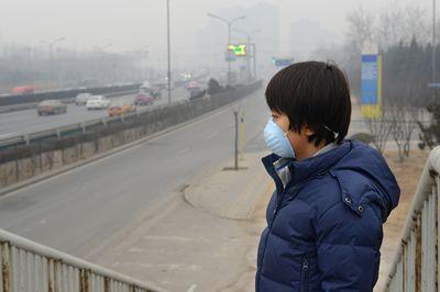 Boy in beijing smog
