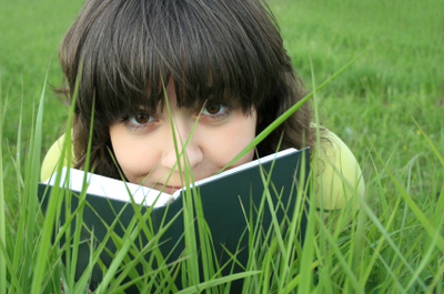 Reading_in_the_grass_istock_0000060