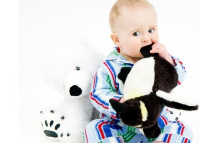 Baby_chewing_on_toy_istock_00000551